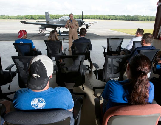"""James """"Chef"""" Barlow, founder and CEO of Blue Air Training, describes the company's mission during a ceremony Friday at Pensacola International Airport."""
