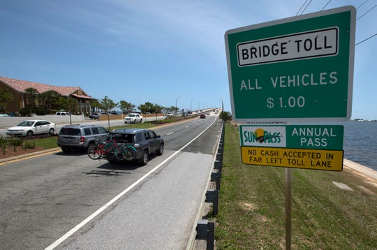Drivers use the Bob Sikes Bridge over Santa Rosa Sound en route to Pensacola Beach on Friday. Later this month, the Escambia County Engineering Department will begin re-striping and installing new signs as part of efforts to upgrade the toll booth lane in front of the Bob Sikes Bridge Toll Plaza entering Pensacola Beach.
