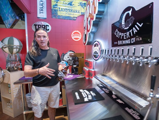 Co-owner Rob Sepe gives a tour Friday of the growler filling station at the new Fusion Fine Wine & Spirits V at the corner of North Ninth Avenue and East Chase Street.