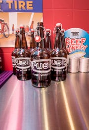 Bottles at the Growler filling station in the new Fusion Fine Wine & Spirits at the corner of N. 9th Avenue and E. Chase Street in Pensacola on Friday, May 3, 2019.