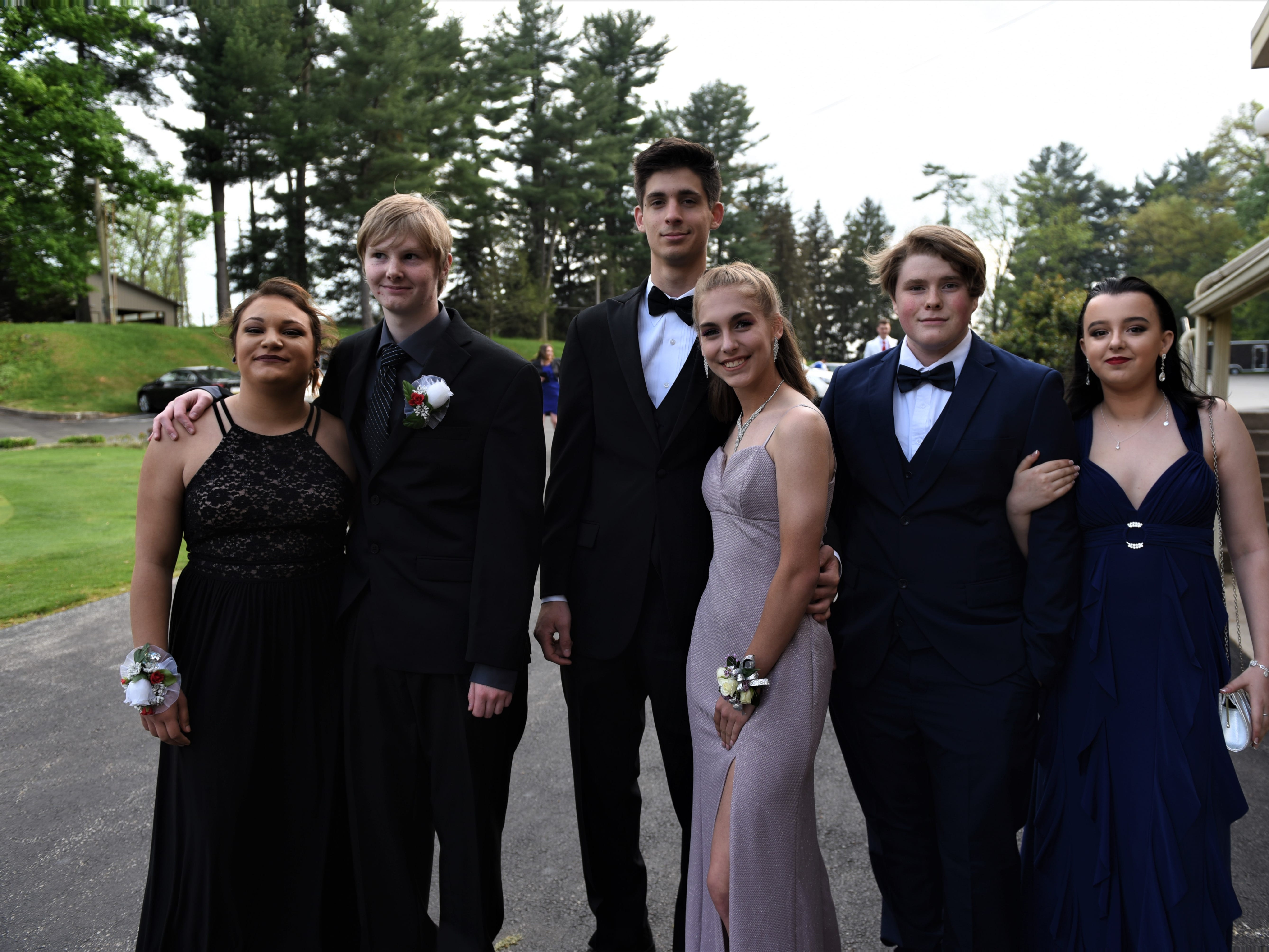 Hanover High School students arrive to their '20s-themed prom night at the Hanover Country Club in Abbottstown on May 3, 2019.