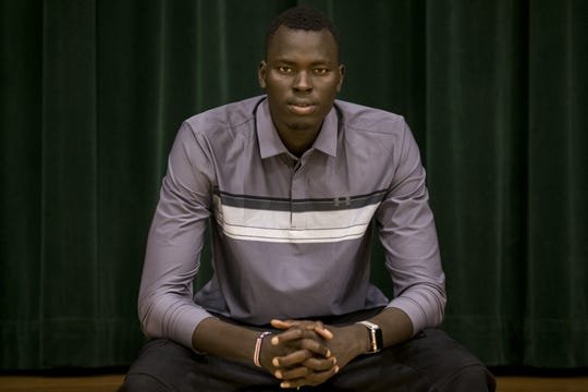 Chol Marial poses for a portrait on Wednesday, Sept. 19, 2018, at AZ Compass Prep in Chandler, Ariz.