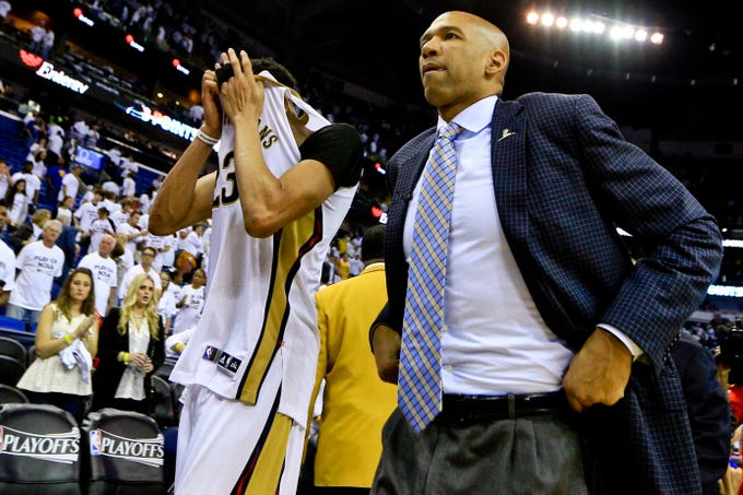 New Orleans Pelicans center Anthony Davis (23) and coach Monty Williams walk off the court after being eliminated from the NBA playoffs by the Golden State Warriors in the 2015.playoffs.