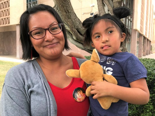 Elayne Gregg poses with her 3-year-old daughter outside the Arizona Senate building on May 2, 2019. Gregg came out in support of House Bill 2570 in honor of her late daughter Rhia Danae Almeida. Almedia was 7-years-old when she was murdered in Ajo, Arizona, in 2009.