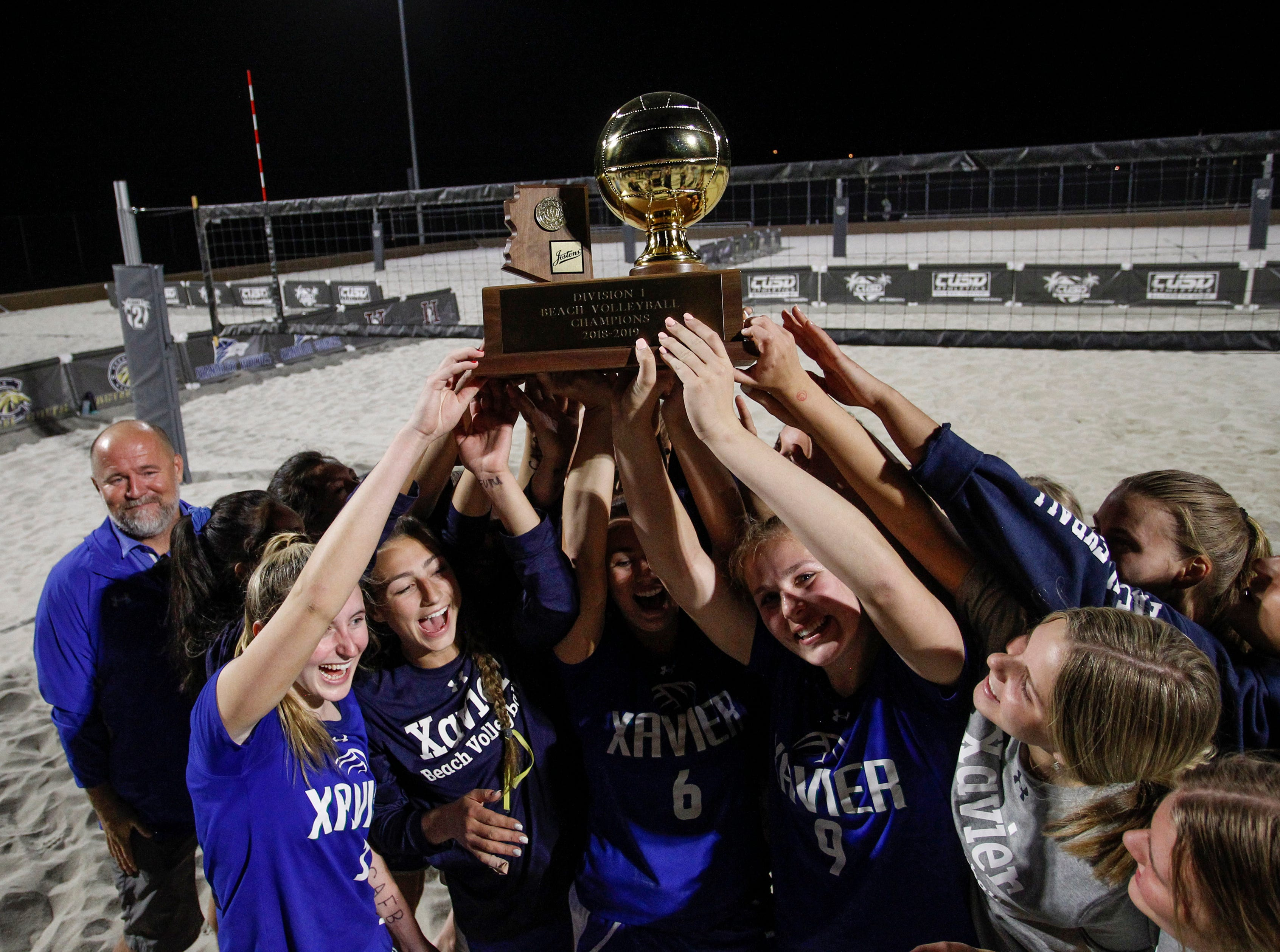 Xavier Prep players hold up the gold ball after winning the Division 1 Team Beach Volleyball State Championships over Perry High School at Casteel High School in Queen Creek, Arizona, May 02, 2019.