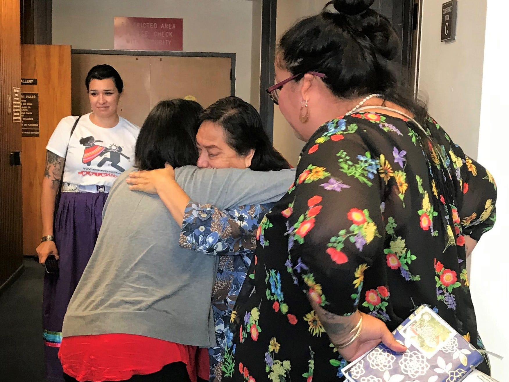 Supporters of House Bill 2570 hug outside the viewing gallery on May 2, 2019. The bill passed the Arizona Senate with a vote of 28 ayes, 0 nayes and 2 not voting.