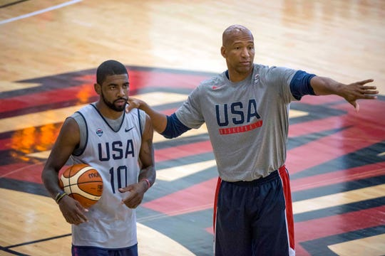 USA Basketball assistant Monty Williams talks with guard Kyrie Irving during a practice in 2016.