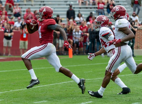 Alabama wide receiver Jerry Jeudy (4) runs in a pass reception for a touchdown during the second half of Alabama's A-Day NCAA college football scrimmage, Saturday, April 13, 2019, in Tuscaloosa, Ala. (AP Photo/Vasha Hunt)