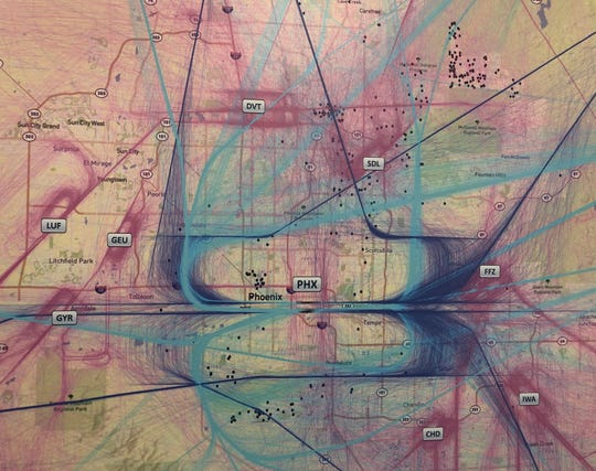 Map of the flight paths of aircraft over Phoenix. Blue and purple represent flights in and out of Sky Harbor. Pink and orange represent general aviation flights. The dots indicate places where the FAA received comments regarding noise.