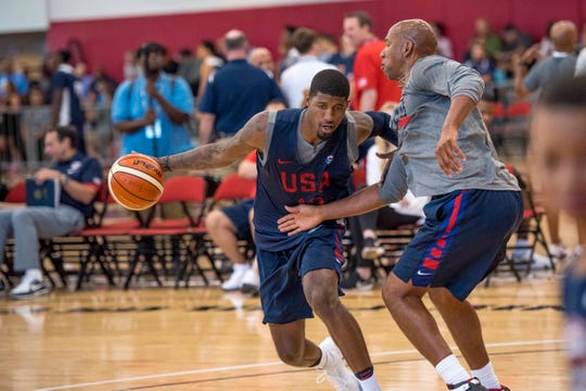 Paul George tries to get by Team USA assistant Monty Williams during a practice in 2016.