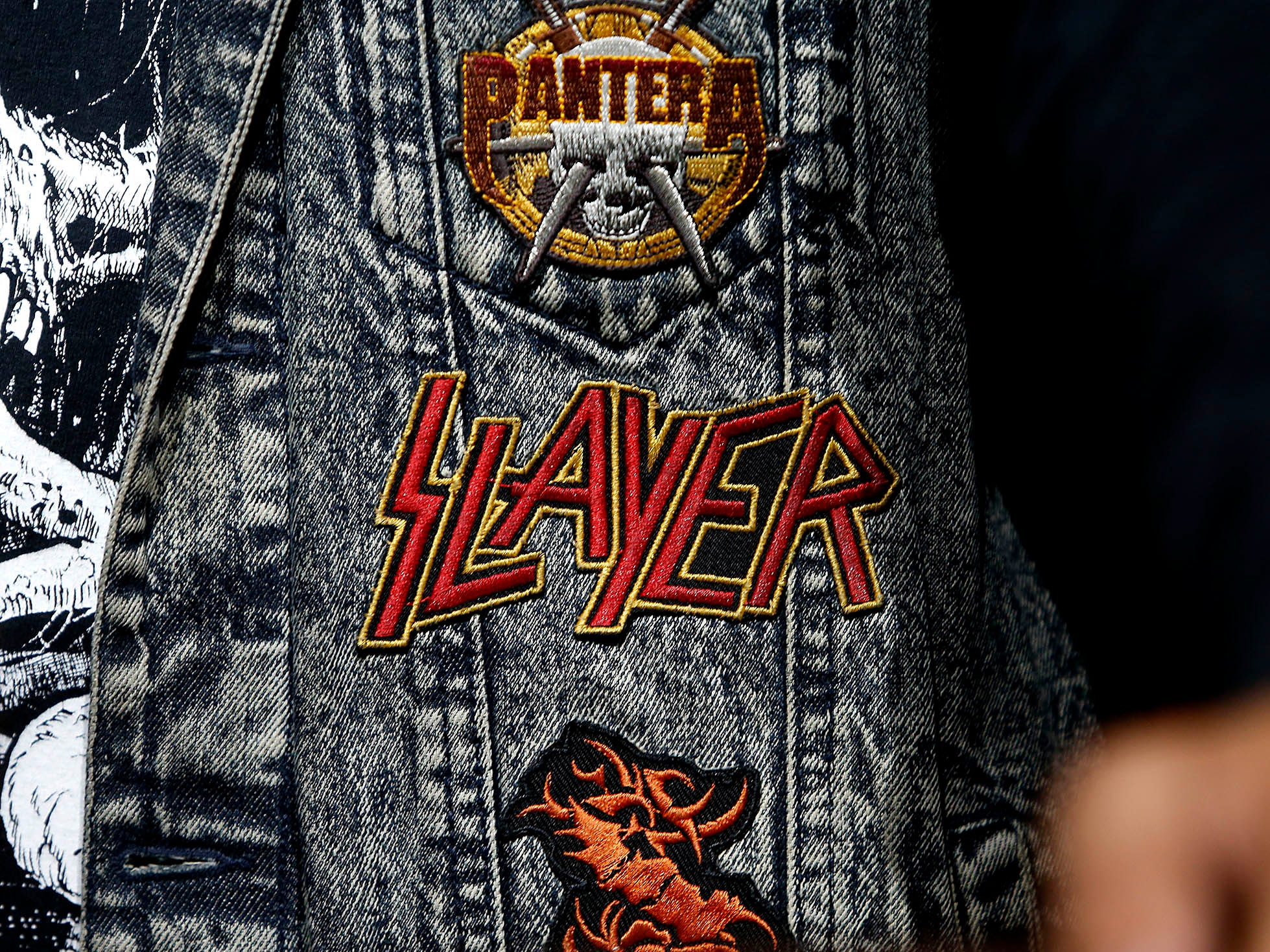 A fan shows their support for Slayer with a patch sewn on their denim jacket during the bands performance at Ak-Chin Pavilion in Phoenix on May 2, 2019.