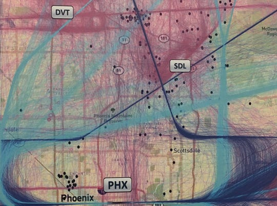 Photo of maps presented during the FAA workshops in April. Purple and light blue represent routes in and out of Sky Harbor. The pink represents the flight paths of general aviation. The dots represent comments received by the FAA during public comment in 2018.