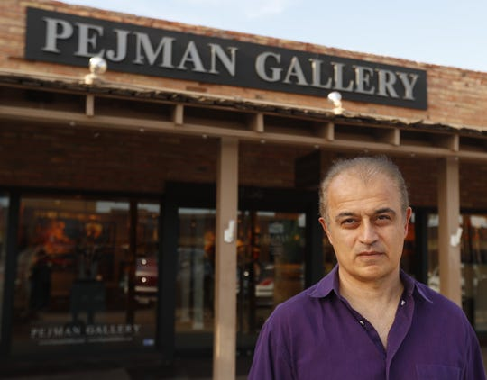 Bob Pejman poses for a portrait outside his gallery in Scottsdale, Ariz. on April 11, 2019.