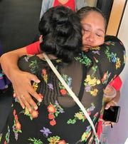 April Ignacio and Debbie Nez Manuel hug after House Bill 2570 passed the Arizona Senate on May 2, 2019.