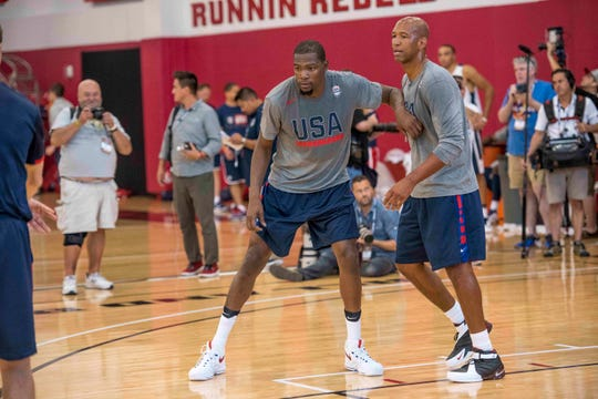 Kevin Durant boxes out USA Basketball assistant coach Monty Williams during a practice in 2016.