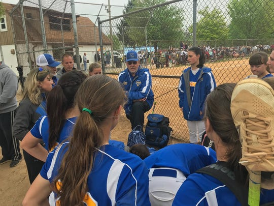 Northern Lebanon softball coach Ed Spittle congratulates his team after Friday's 2-1 win over Manheim Central that moved the Vikings closer to a Lancaster-Lebanon League playoff berth.