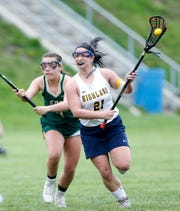 Highland's Eliz Fino races up field during a May 2 girls lacrosse game against Franklin D. Roosevelt. Fino, two weeks later, set the state single-season record for goals scored.