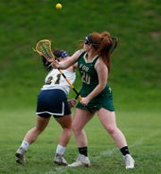 Highland's Eliz Fino and FDR's Amelia Booth following a draw during Thursday's game on May 2, 2019.