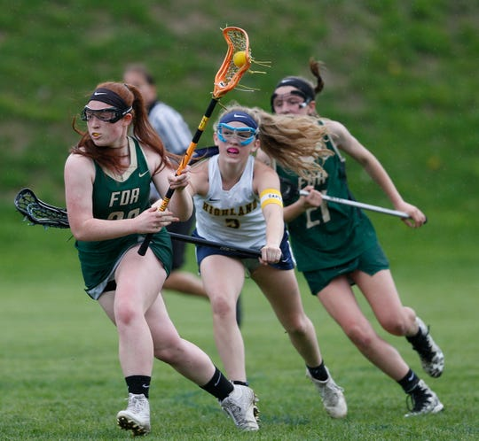 FDR's Amelia Booth carries the ball away from Highland's Emma Beck during Thursday's game on May 2, 2019.