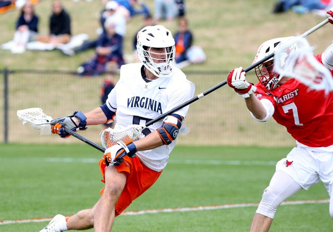 Marist's Sam Ahlgrim defends a Virginia player during their men's lacrosse match on April 20, 2019, in Charlottesville, Virginia.