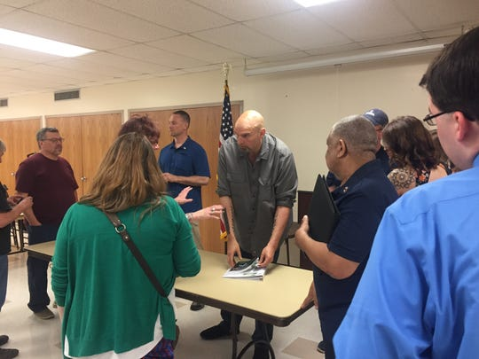 "Lt. Gov. John Fetterman, center, talks with local residents after taking his ""listening tour"" on recreational marijuana legalization to Chambersburg."