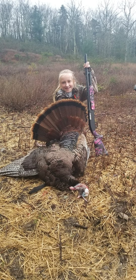 Grace Shepheard, age 9, poses with her gobbler at Michaux State Forest.
