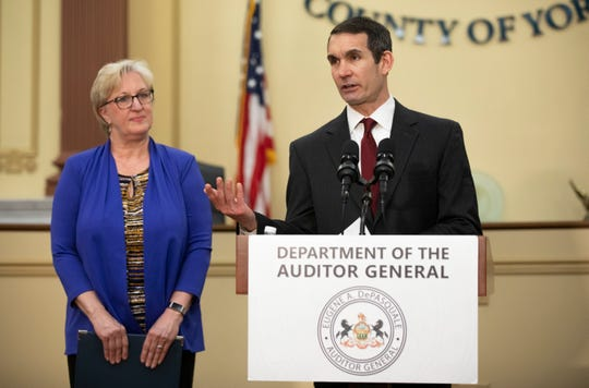Pennsylvania Auditor General Eugene DePasquale, right, speaks during a news conference at the York County Administrative Center on Friday. York County Recorder of Deeds Laura Shue is pictured on the left.