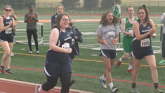 Dallastown Unified track and field athletes cheer on a teammate during the 100-meter dash during a meet at Central York on Friday.