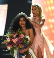 Miss North Carolina Chelsie Kryst gets crowned by last year's winner Sarah Rose Summers after winning the 2019 Miss USA final competition in the Grand Theatre in the Grand Sierra Resort in Reno on May 2, 2019.