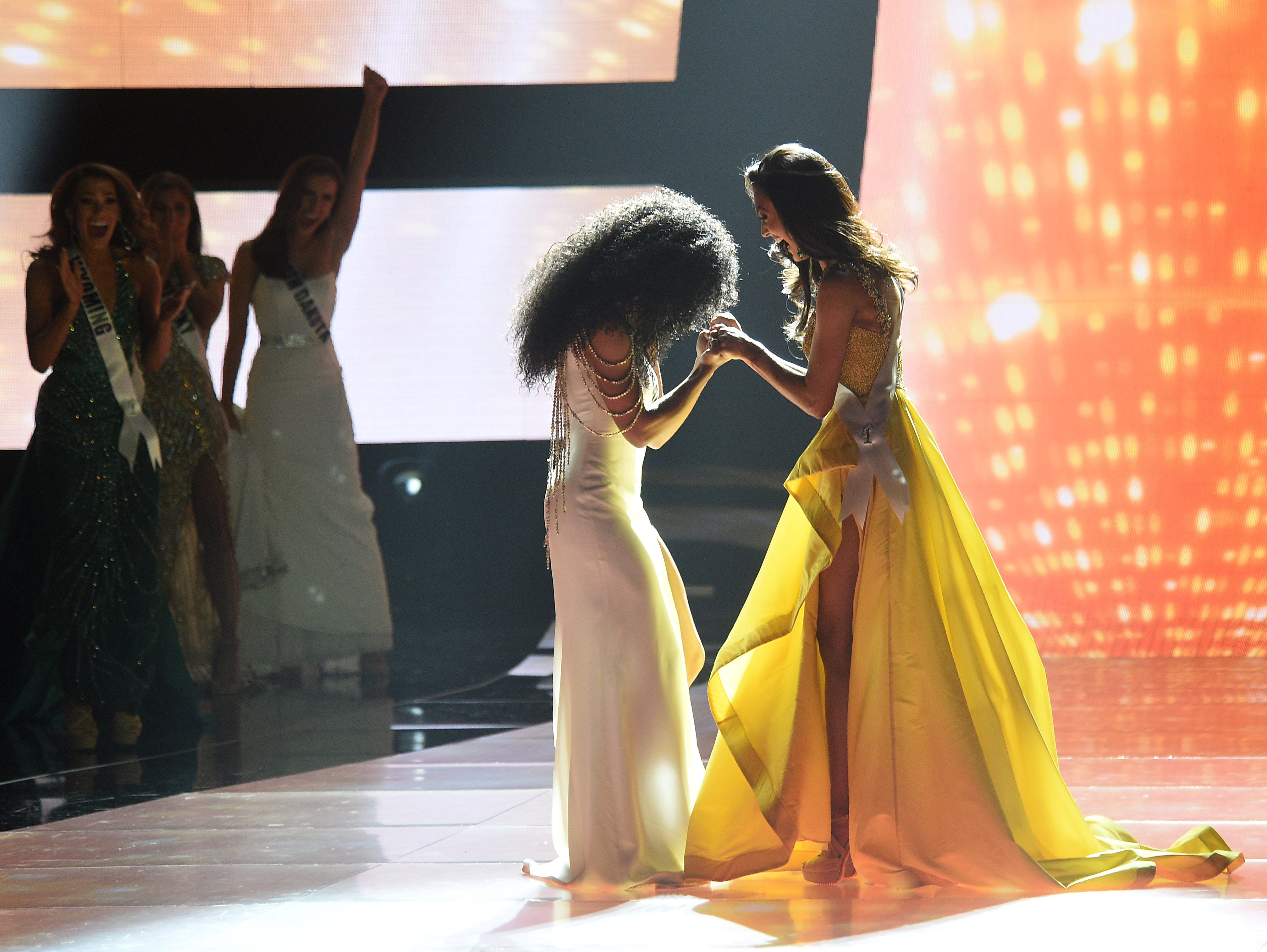 Miss North Carolina Cheslie Kryst, left, wins the 2019 Miss USA final competition in the Grand Theatre in the Grand Sierra Resort in Reno on May 2, 2019.
