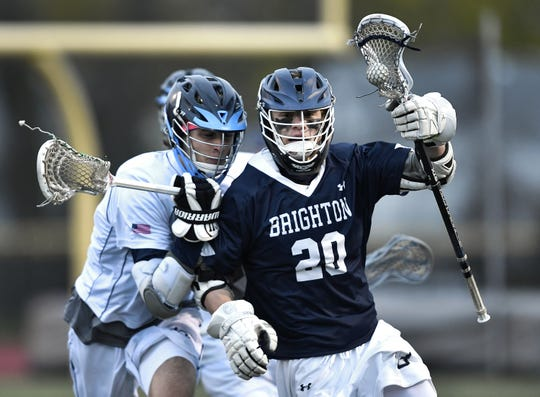 Brighton's Sam Tourangeau, right, is defended by Eastridge's Vincent Fagan during a game at Eastridge High School, Thursday, May 2, 2019. Tourangeau picked up 11 groundballs in Brighton's 16-5 win.