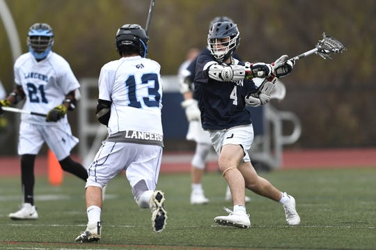 Brighton's Najeeb Awad, right, winds up a shot while defended by Eastridge's Alex Wood during a game at Eastridge High School, Thursday, May 2, 2019.