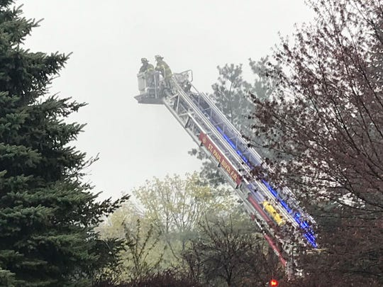 Firefighters douse flames at a fire on Saint Joseph Street in Irondequoit Friday morning. The blaze heavily damaged two buildings and destroyed a third and Irondequoit Landscape.