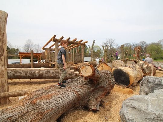 The Lilac Adventure Zone at Highland Avenue near Meadowbrook Road is made almost entirely from repurposed timbers and rocks from other Monroe County parks and looks like a life-size Lincoln Log village.