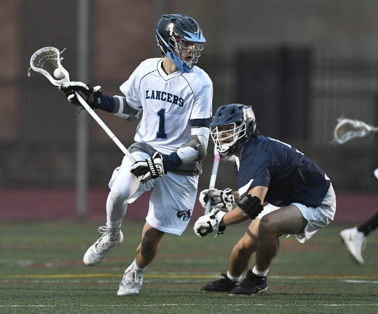 Eastridge's Vincent Fagan, left, is defended by Brighton's Vaughn Fetkenhour during a game at Eastridge High School, Thursday, May 2, 2019.