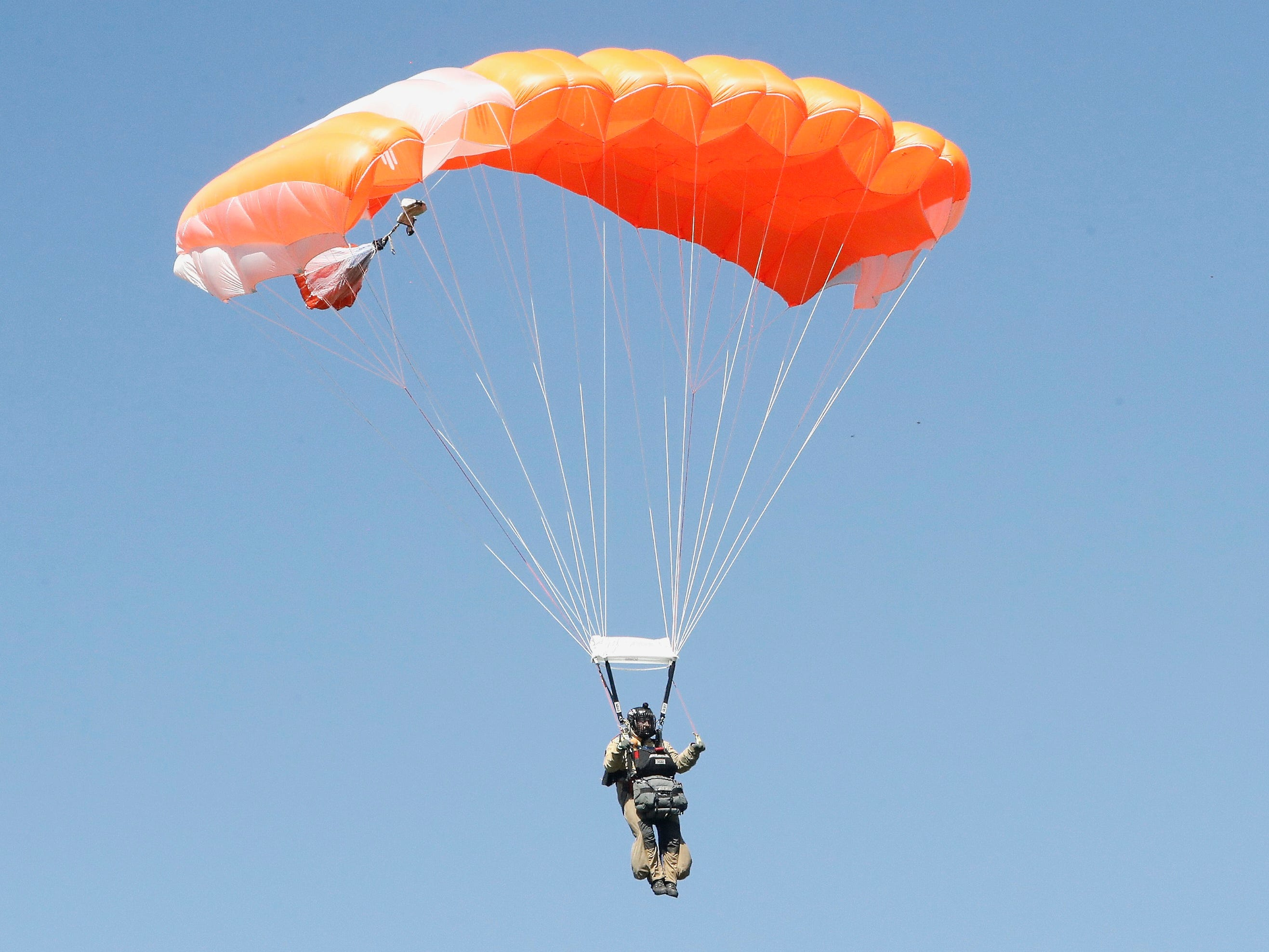 A smokejumper descends to earth during aerial firefighting training.