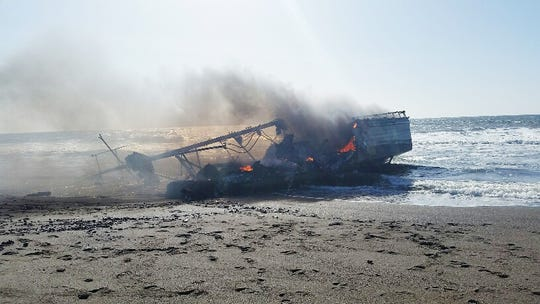 A large boat caught fire off Oregon's southern coast Thursday and eventually came aground May 2.