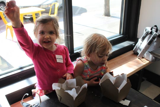 Audrey Sturzinger, 4, and Claire Sturzinger, 2, are happy customers at Bigwig Donuts soft opening on May 3, 2019
