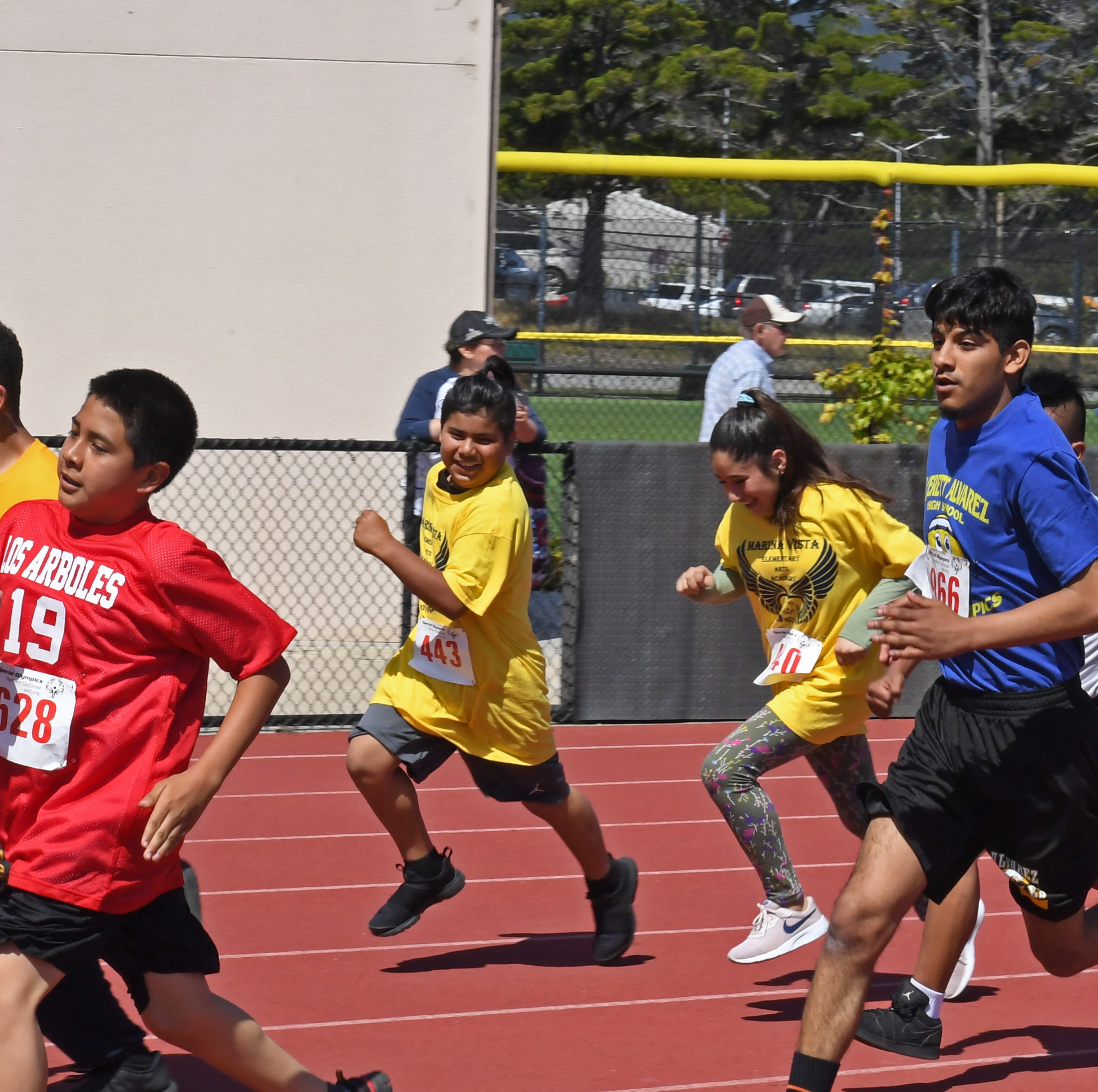 Monterey County Special Olympics athletes bond with other students at annual track meet