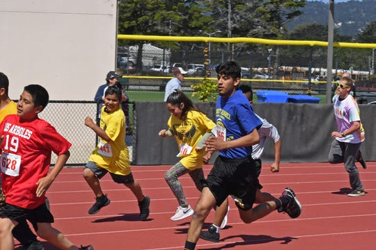 Runners in the 400-meters round the first corner Friday at Special Olympics Monterey County's meet at Monterey Peninsula College.