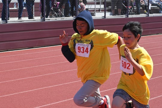 Two runners from Marina Vista Elementary sprint to the finish in the one-mile event.