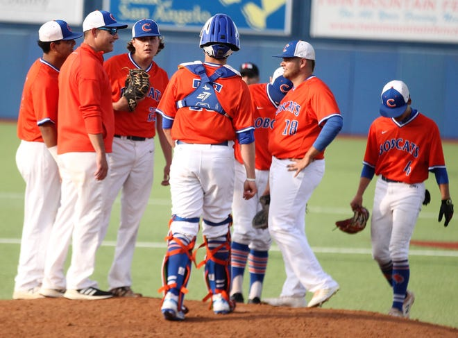 San Angelo Central head baseball coach Patrick Penry (second from left) and the Bobcats have a meeting on the mound in Game 1 of a bidistrict playoff series against Arlington Lamar at Angelo State University Thursday, May 2, 2019.