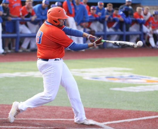 San Angelo Central's Dawson Daniel connects on a pitch in Game 1 of a bidistrict playoff series against Arlington Lamar at Angelo State University Thursday, May 2, 2019.