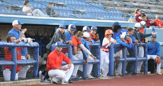 The San Angelo Central baseball team and coaches watch from the dugout in Game 1 of a bidistrict playoff series against Arlington Lamar at Angelo State University Thursday, May 2, 2019. Head coach Patrick Penry watches with sunglasses.