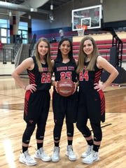 Garden City High School seniors Allison Halfmann, from left to right, Ixchel Sotelo and Lyndee Walker were part of the Lady Bearkats' basketball team.