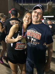 Ixchel Sotelo celebrates a bronze medal at the UIL State Track and Field Meet with her father Felipe Sotelo.