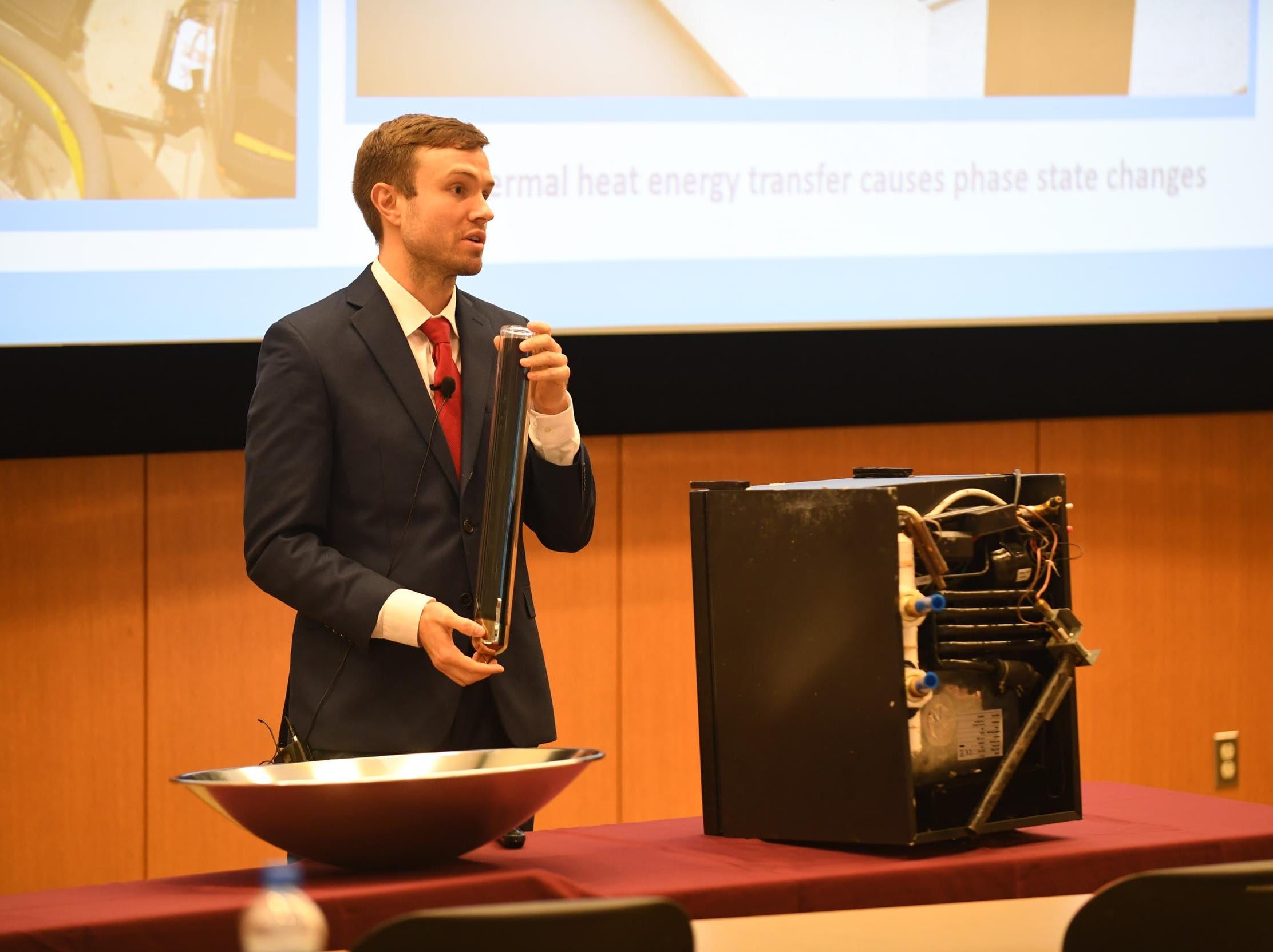 Salisbury University Student, Ronald Cavelius, presents his invention the Solar Green HVAC to a group of judges during the Franklin P. Perdue School of Business annual Entrepreneurship Competitions on Thursday, May 2, 2019.