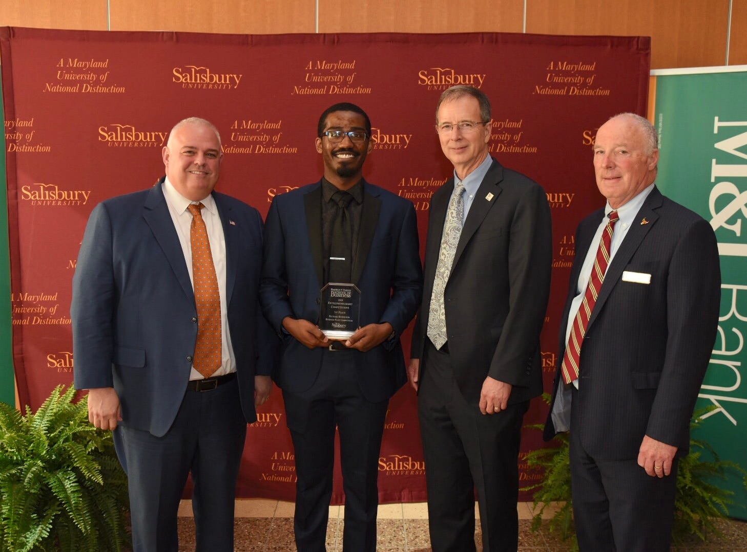 Kevin Bernstein, Vice President of LWRC International, LLC, Cameron Kane-SU's Bernstein Achievement Award for Excellence Valkyrie Software Solutions , Salisbury University President Charles Wight and William Burke, SU executive director for economic development and director of the Entrepreneurship Competitions.