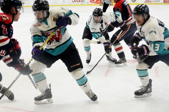 Gueorgui Feduolov (left) and Jay Feiwell (13) played their final game on George's Pond at Hirsch Coliseum on Thursday. Their efforts helped Shreveport keep its hope alive in the 2019 NAHL playoffs.