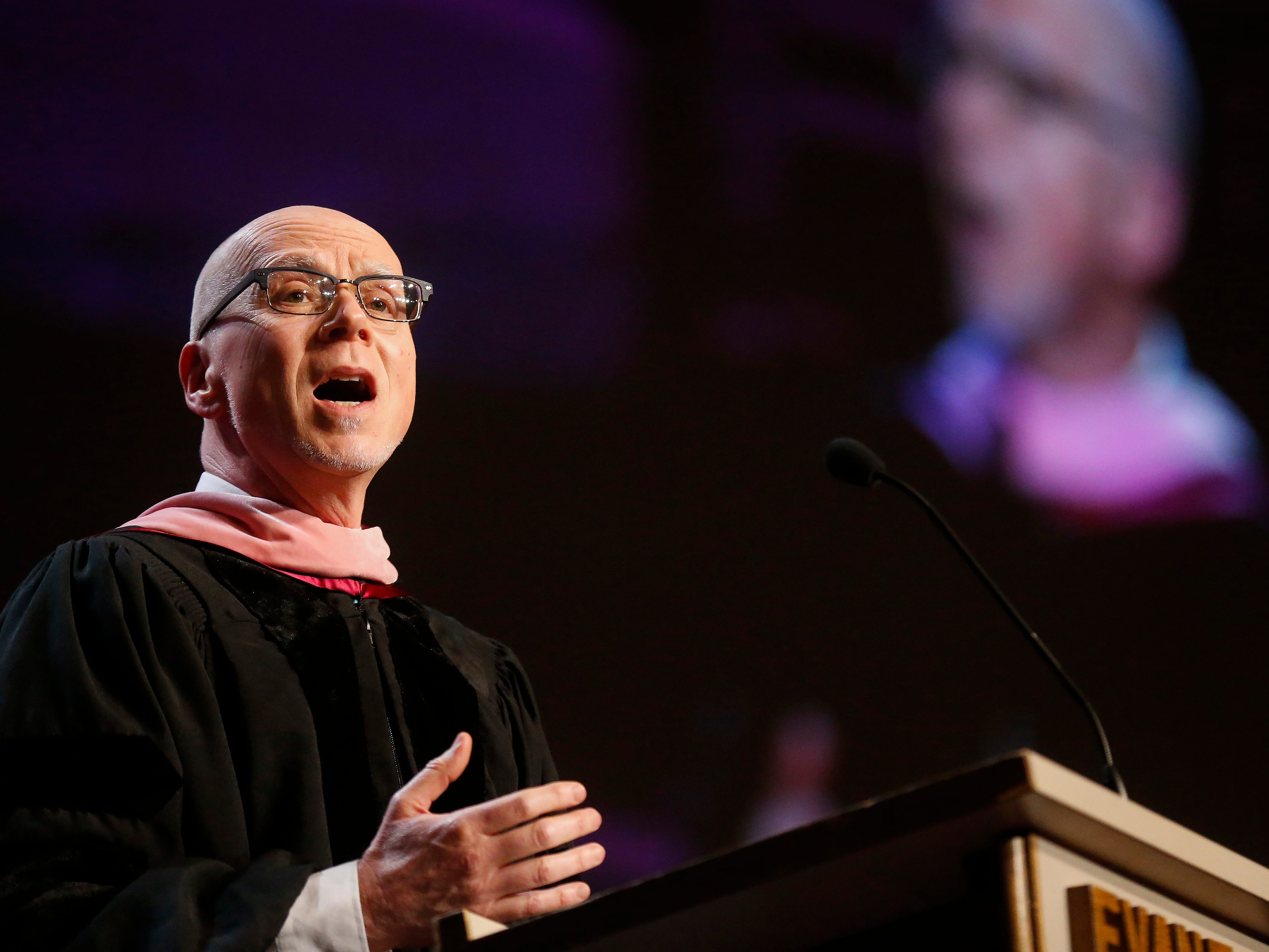 Thomas Matrone leads the crowd in a song during Evangel University's 2019 Commencement Ceremony at James River Church in Ozark on Friday, May 3, 2019.